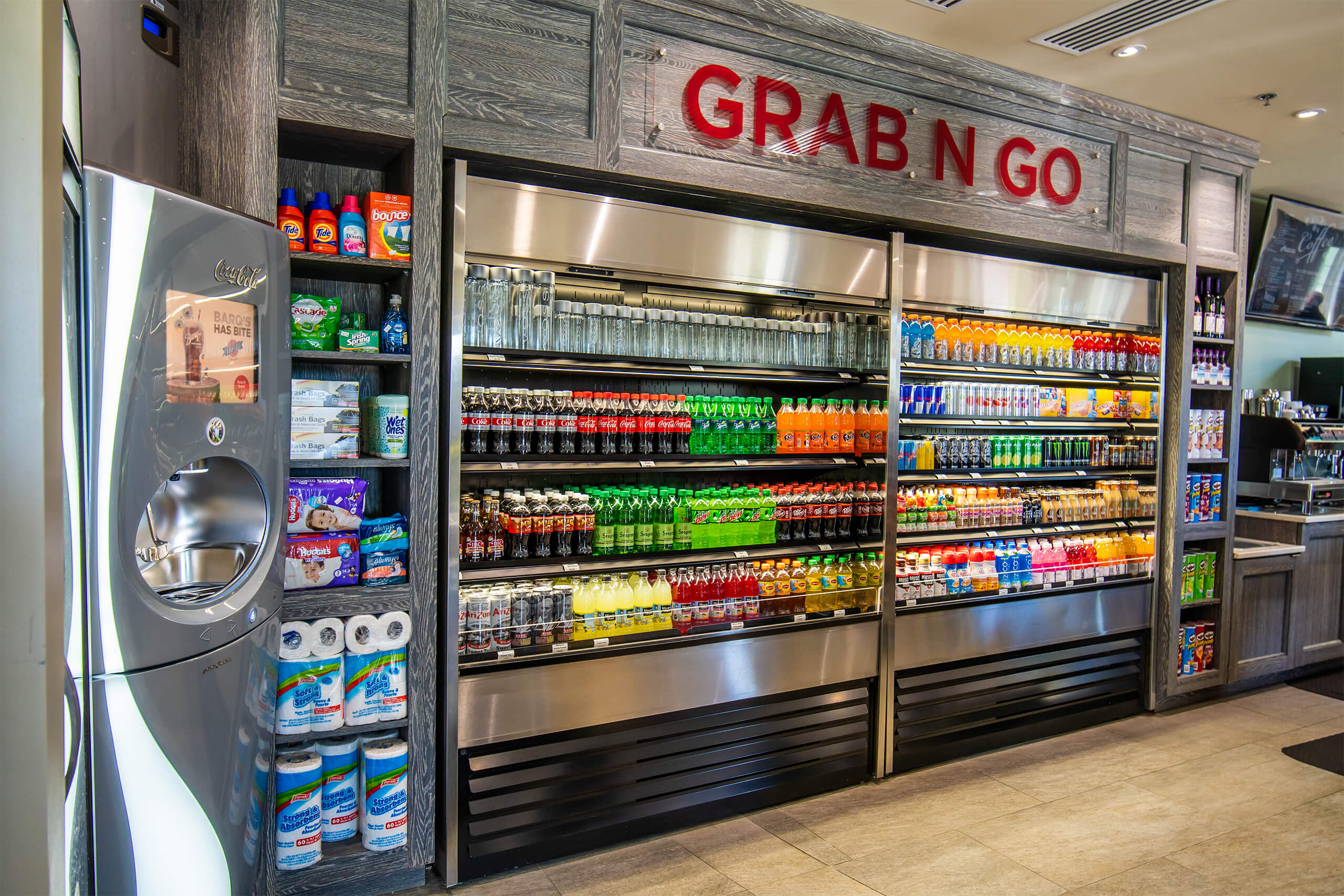 The Encore Resort Clubhouse Grab 'N Go store's refrigerator filled with soft drinks and other beverages.